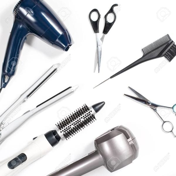 Various hair styling tools on white background
